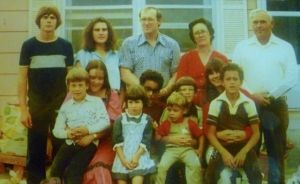 Barbara and Bill Roberts (back row, right) with their children, including my dad, back row middle.